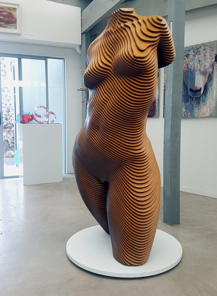 A large female torso in laminated wood