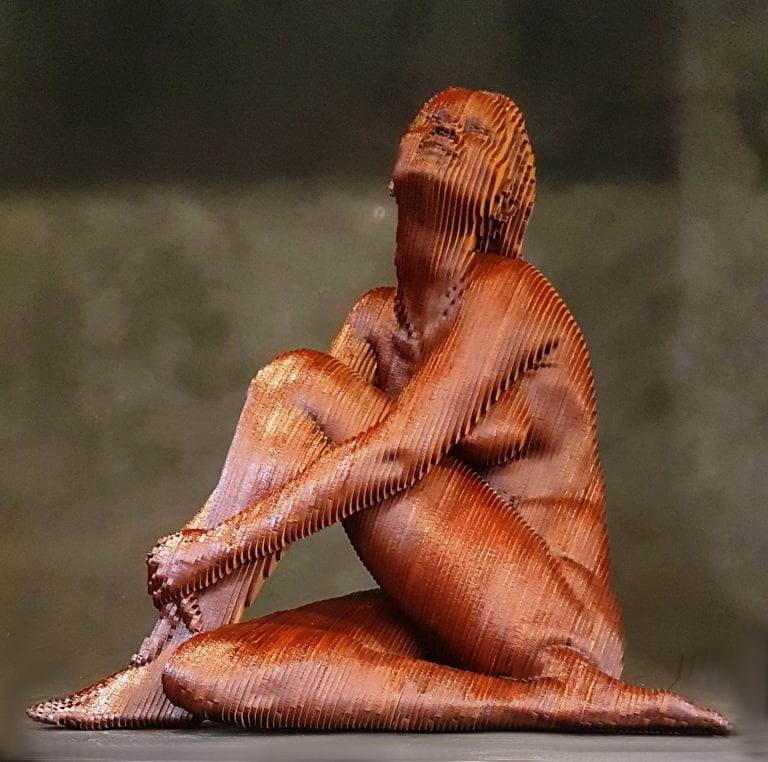 Marianne, a wooden sculpture of a nude woman sitting