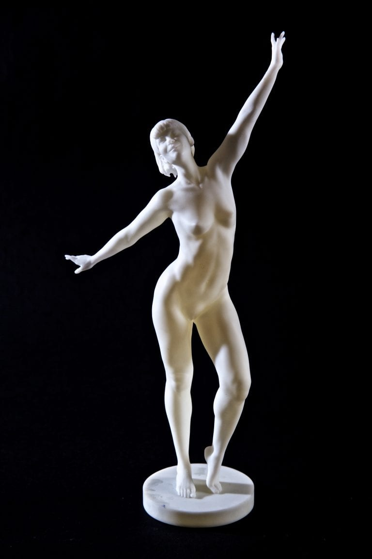 figurine of a nude woman standing