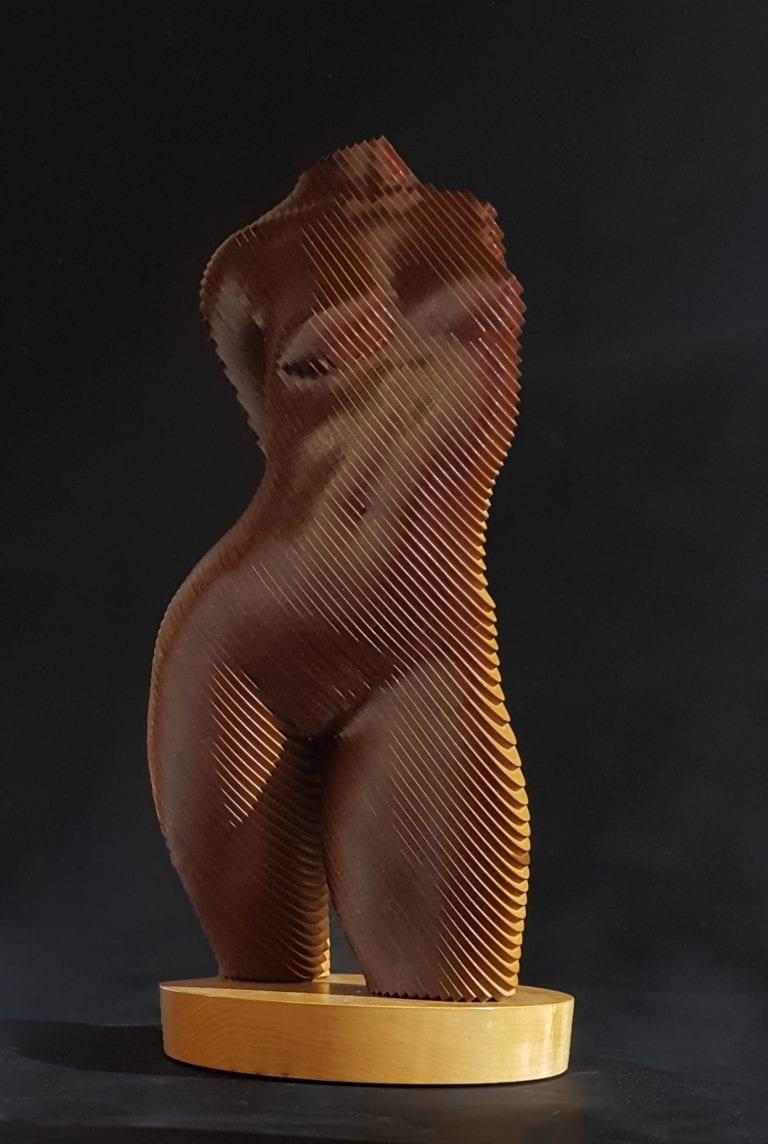 wooden sculpture of a nude female torso