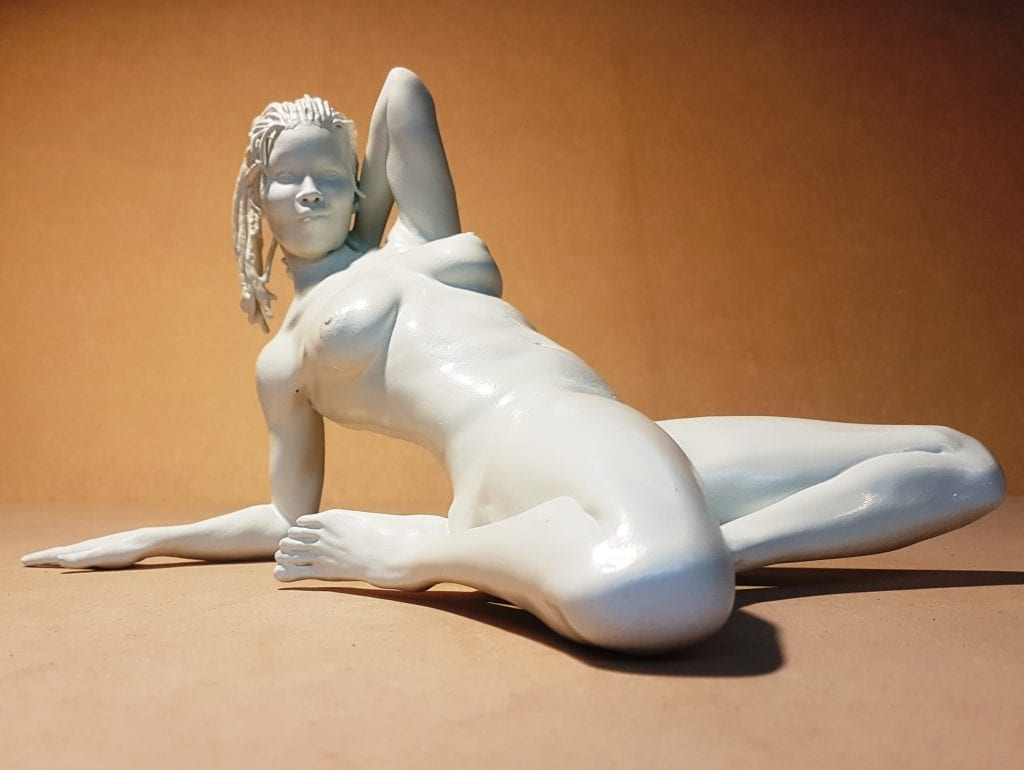 Statuette of a young woman leaning back
