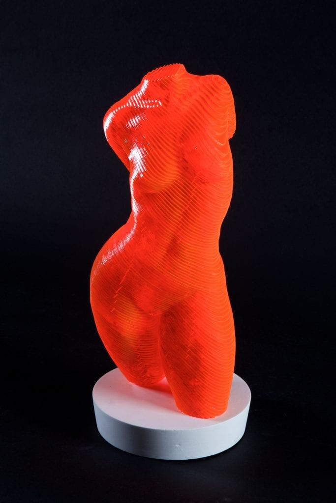 orange sculpture of as nude female torso