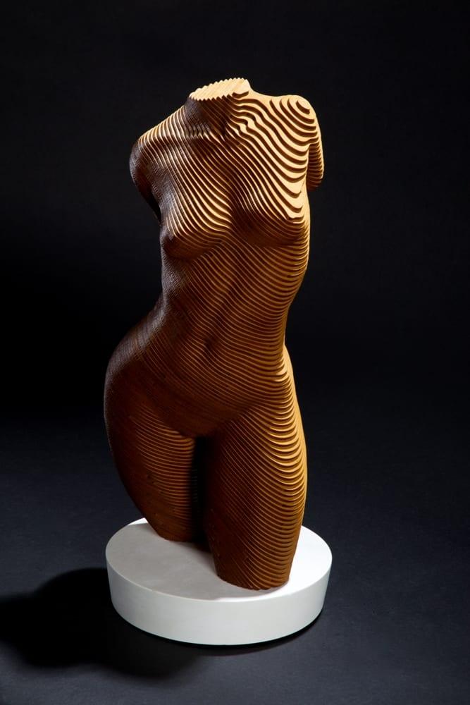 A nude female torso in laminated wood