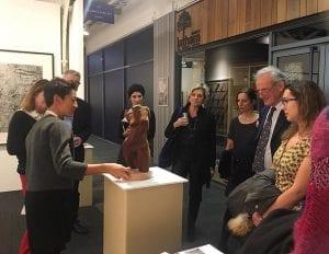 Gallery visitors admiring Rosie