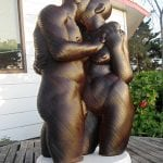 Wood sculpture of a couple kissing