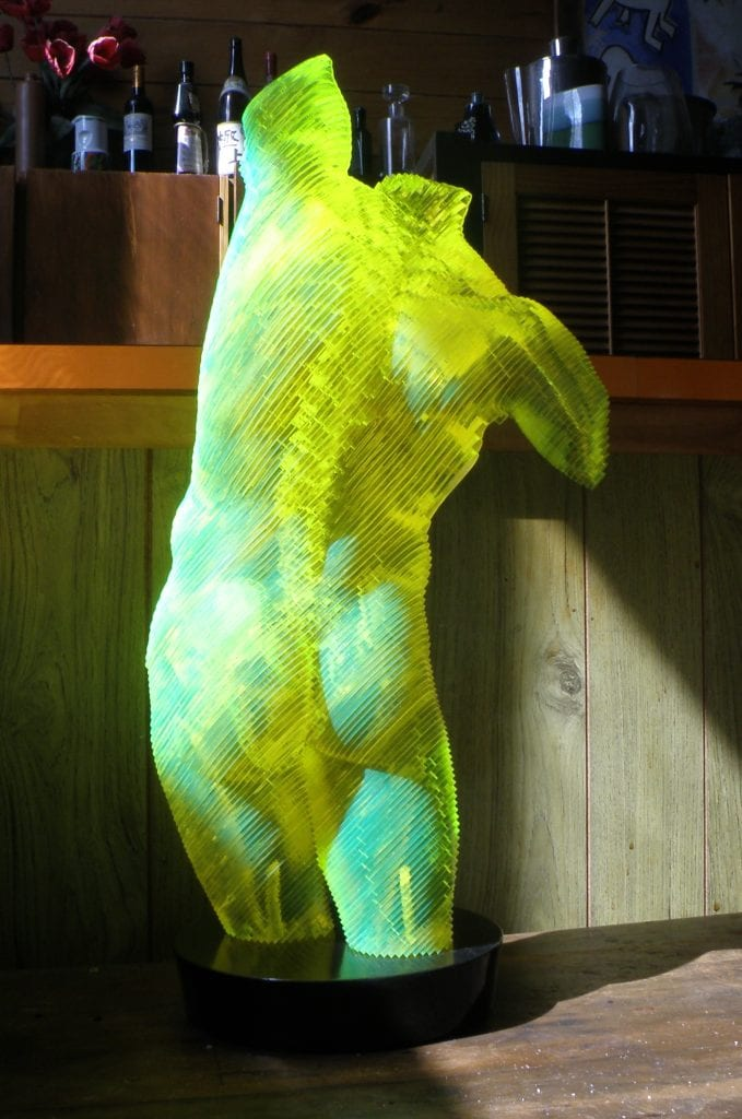 a sculpture in acrylic of a nude male torso