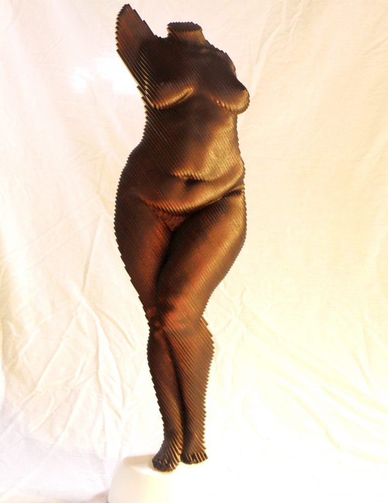 Wood sculpture of a fat nude woman standing