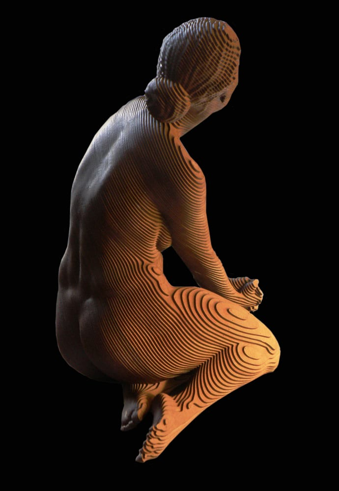 wooden sculpture of a nude woman sitting