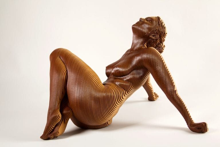 wooden sculpture of a nude young woman sitting and leaning back