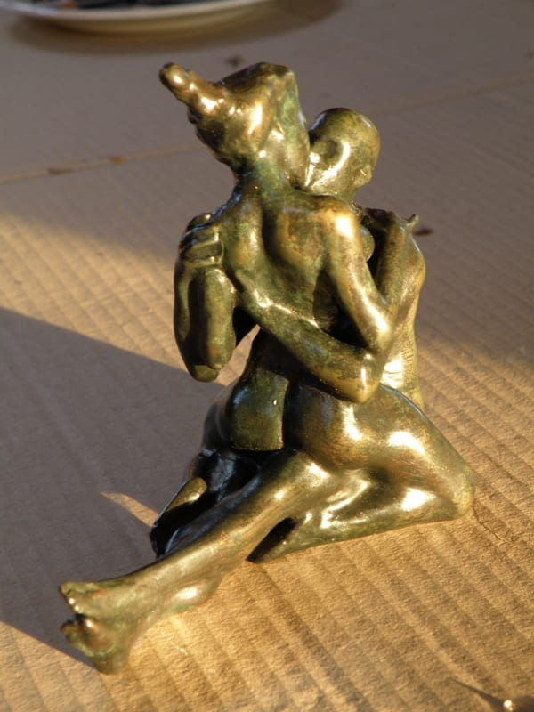 small bronze figurine of a couple kissing