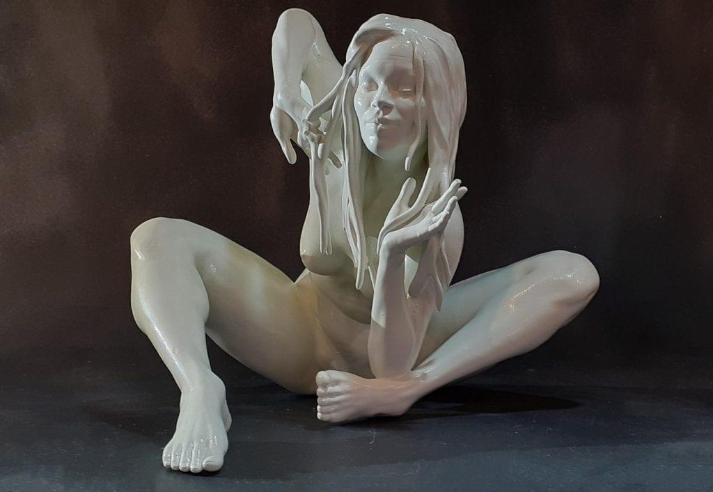 nude female white figurine seating
