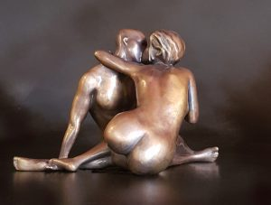 Nude couple kissing and holding hands