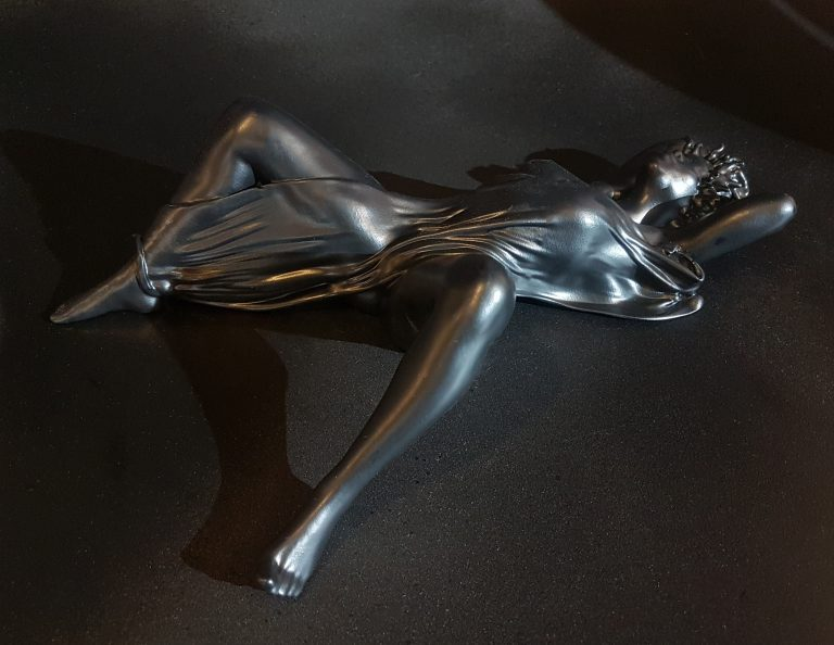 Nude woman lying on her back with open legs